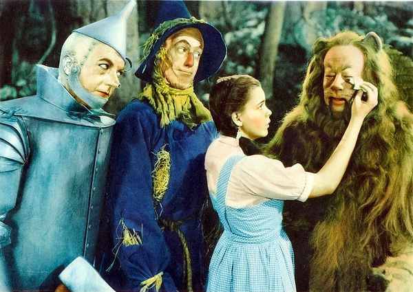 Publicity still of the Wizard of Oz, showing the Tin Man, Scarecrow, Dorothy and Cowardly Lion