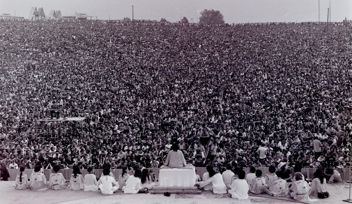 Swami Satchidananda addressing the opening ceremony at Woodstock